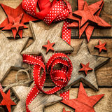 Christmas decorations wooden stars and red ribbons Stock Image