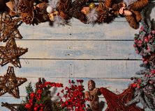 Christmas decorations and wooden table. Royalty Free Stock Photo