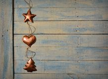 Christmas decorations and wooden table. Royalty Free Stock Photos