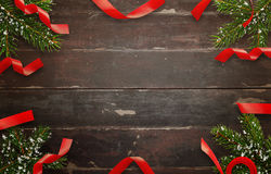 Christmas decorations on wooden table. Top view of table with christmas tree and decorative strips Royalty Free Stock Images