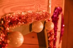 Christmas decorations on a wooden wall royalty free stock image