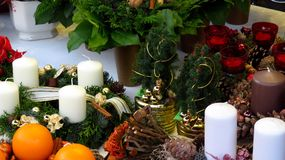 Christmas Decorations and Wreaths. A collection of colorful Christmas decorations and wreaths with advent candles at a Christmas market Royalty Free Stock Images