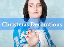 Christmas decorations written on virtual screen. concept of celebratory technology in internet and networking. woman in Stock Photography