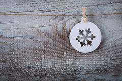 Christmas decorations (snowflake) hanging over wooden background Stock Photos