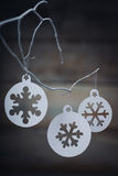 Christmas decorations (snowflake) hanging over wooden background Stock Photography
