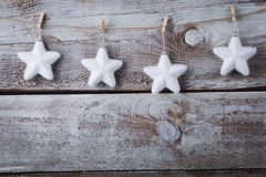 Christmas decorations (snowflake) hanging over wooden background Royalty Free Stock Photos
