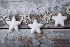 Christmas decorations (snowflake) hanging over wooden background Stock Photo