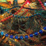 Christmas decorations on xmas tree Royalty Free Stock Photography
