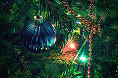 Christmas decorations on xmas tree Stock Images
