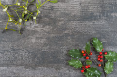 Christmas decorative background with decorations, holly, mistletoe on old grey vintage royalty free stock image