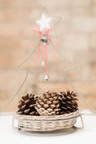 Christmas decorative basket with pine cones Royalty Free Stock Image