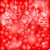 Christmas decorative baubles on red blur background Royalty Free Stock Photos