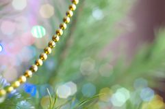 Christmas decorative beads hanging on the Christmas tree close-up.  Christmas background , Christmas decorations