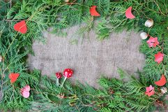Christmas decorative border. On the burlap background Stock Images
