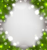 Christmas decorative border from fir twigs, glowing background Stock Photo