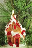 Christmas decorative candle burning house in fir branches. Close-up stock image