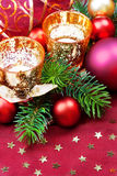 Christmas decorative candles and baubles. Royalty Free Stock Photography