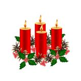 Christmas decorative composition. Four burning wax candles of re. D color. Decorated with a wreath of fir cones and a twig holly with berries. Isolated. White Royalty Free Stock Photo