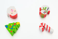 Christmas decorative dolls of snowman fir-tree stick and santa claus Stock Photos