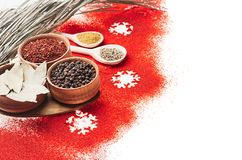 Christmas decorative food border of red chili pepper powder and dry seasoning in wooden bowls, closeup. stock image