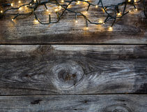 Christmas decorative garland on vintage wooden timbers for country background. Christmas decorative garland on retro vintage wooden timbers for genuine country royalty free stock photo
