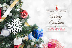 Christmas decorative with gift box and snowflake. On christmas tree and Merry Christmas and Happy New Year 2017 text on bokeh light background Royalty Free Stock Photography