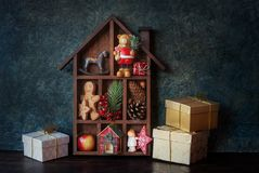 Christmas decorative house. Wooden Christmas decorative house with gifts, Christmas decoration and cookies royalty free stock photos