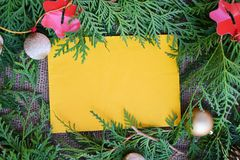 Christmas decorative invitation. Christmas decorative border around yellow paper background Royalty Free Stock Images