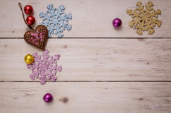 Christmas decorative objects on wooden backgorund, top view Royalty Free Stock Photos