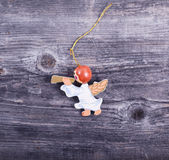 Christmas decorative ornament - Angel with flute on wooden backg Royalty Free Stock Photography