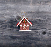 Christmas decorative ornament - Cake house on wooden background Stock Photography