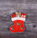 Christmas decorative ornament - Gifts in sock horses on wooden b Royalty Free Stock Image