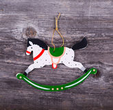 Christmas decorative ornament - Horse ornament on wooden backgro Stock Photography