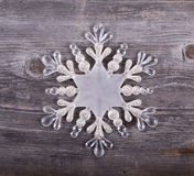 Christmas decorative ornament - Snowflake on wooden background Stock Photo
