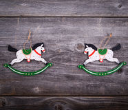 Christmas decorative ornament - Two wooden horses on wooden back Royalty Free Stock Photo