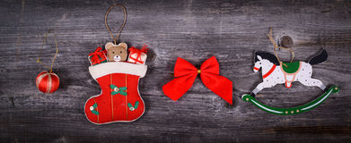 Christmas decorative ornaments on wooden background Royalty Free Stock Photo