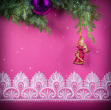 Christmas decorative pink background with lace and statuary of a. Christmas decorative pink background with white lace and statuary of angel Stock Images