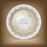 Christmas decorative plate with circular lace pattern Stock Photo