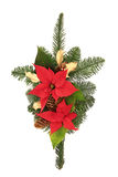 Christmas Decorative Spray. Christmas decoration of poinsettia flower heads, golden holly, pine cones and spruce fir leaf sprig isolated over white background Royalty Free Stock Photos