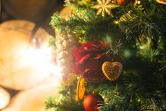 Christmas decorative tree with gifts boxes toys and fire. Festive background bokeh lights holiday concept Stock Images