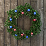Christmas decorative wreath with balls on wood Royalty Free Stock Photography