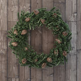 Christmas decorative wreath with cones on wood Stock Photos