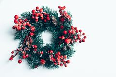 Christmas decorative wreath of holly, ivy, mistletoe, cedar and leyland leaf sprigs with red berries over white background.  royalty free stock images