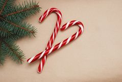 Christmas decors with craft paper background. Candy cane and fir branches. stock photography