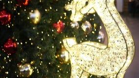 Christmas deer around dressed up Christmas tree. Christmas deer Christmas tree lights around dressed up stock video footage