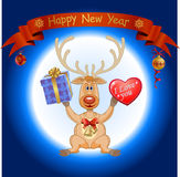 Christmas deer with a big heart Stock Images