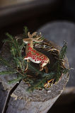 Christmas deer decoration on pine wreath. On wooden log Stock Images