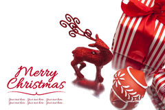 Christmas deer, gift box and ornament on white background Royalty Free Stock Photography