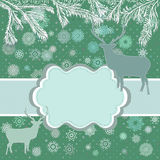 Christmas deer with greeting card Royalty Free Stock Image