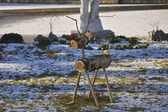 Christmas deer made from wooden parts. Standing on the playground Stock Photography